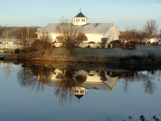 Pelican Ridge Clubhouse and Fishing Pond in the Fall